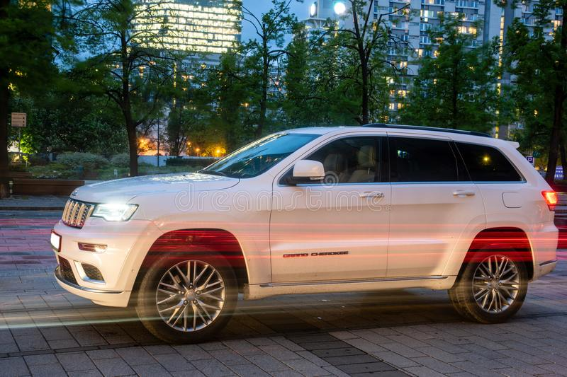 New SUV Jeep Grand Cherokee model against the background of modern buildings in Warsaw. Warsaw, Poland-April 2018: New SUV Jeep Grand Cherokee model against the stock photography
