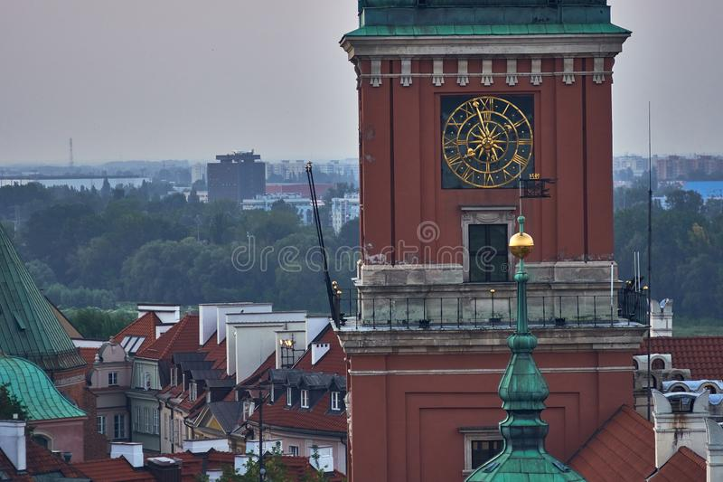 Warsaw, Poland - August 11, 2017: Beautiful aerial night panoramic view of clock tower, Plac Zamkowy square in Warsaw, with. Historic building, including royalty free stock photo