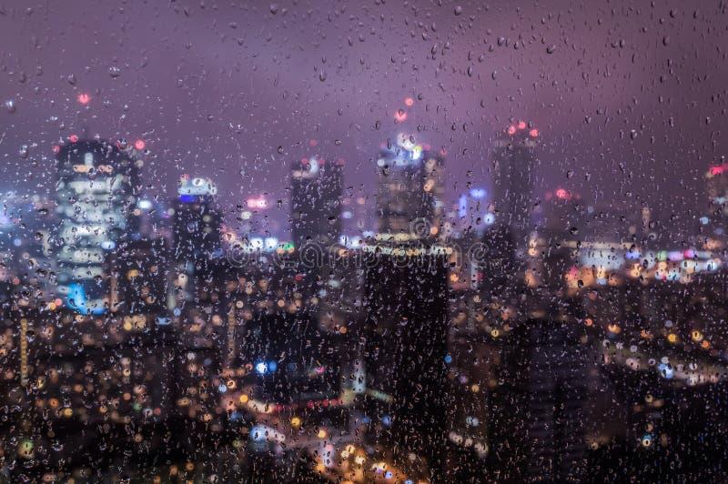Warsaw, Poland city center through glass window on rainy day stock image