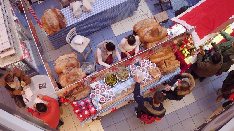 WARSAW, POLAND - DECEMBER, 18, 2016. Christmas bazar booth with bread and cucumber sandwiches. Top view. WARSAW, POLAND - DECEMBER, 18, 2016. Christmas bazar stock photo