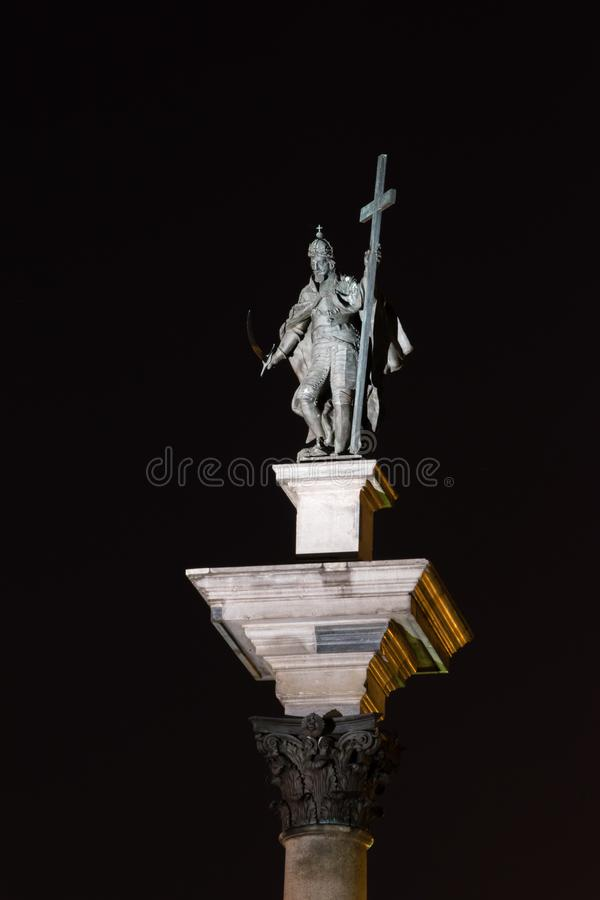 King Sigismund III Vasa on the top of Sigismund`s Column in Old town of Warsaw at night royalty free stock photography