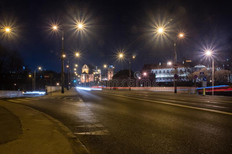 View for old town of Warsaw from Slasko-Dabrowski Bridge at night stock photo