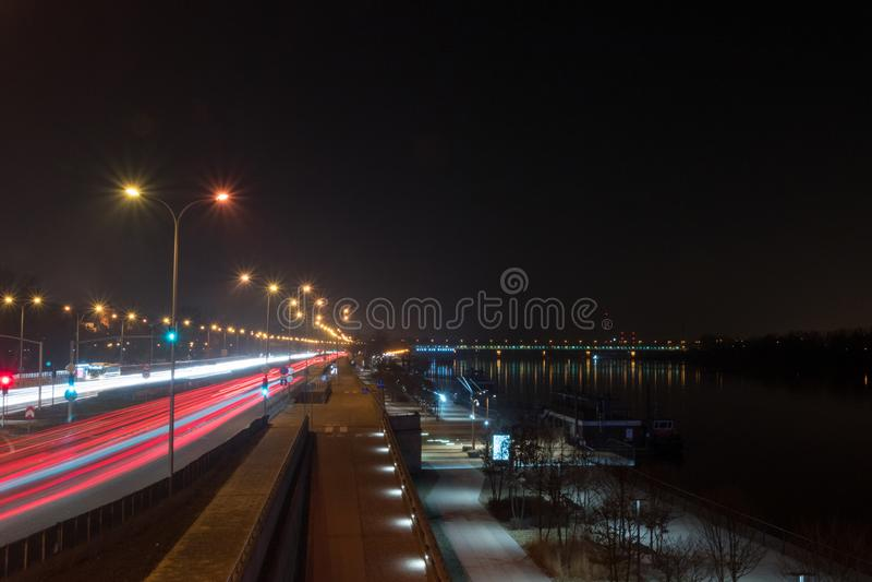 Vistulan Jan Karski boulevard near Slasko-Dabrowski bridge at night stock image