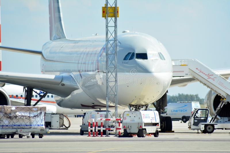 A7-AEC Qatar Airways Airbus A330-302 . The plane at the airport on loading at the airport in Chopin airport royalty free stock images