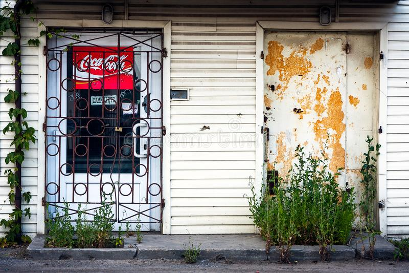 Coca cola red sign, abandoned building stock photo
