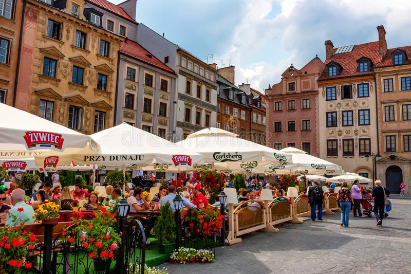 WARSAW, POLAND - JUNE, 2012: Old Town market place. WARSAW, POLAND - JUNE, 2012: Beautiful view of Old Town market place on sunny day with lots of tourists royalty free stock photo