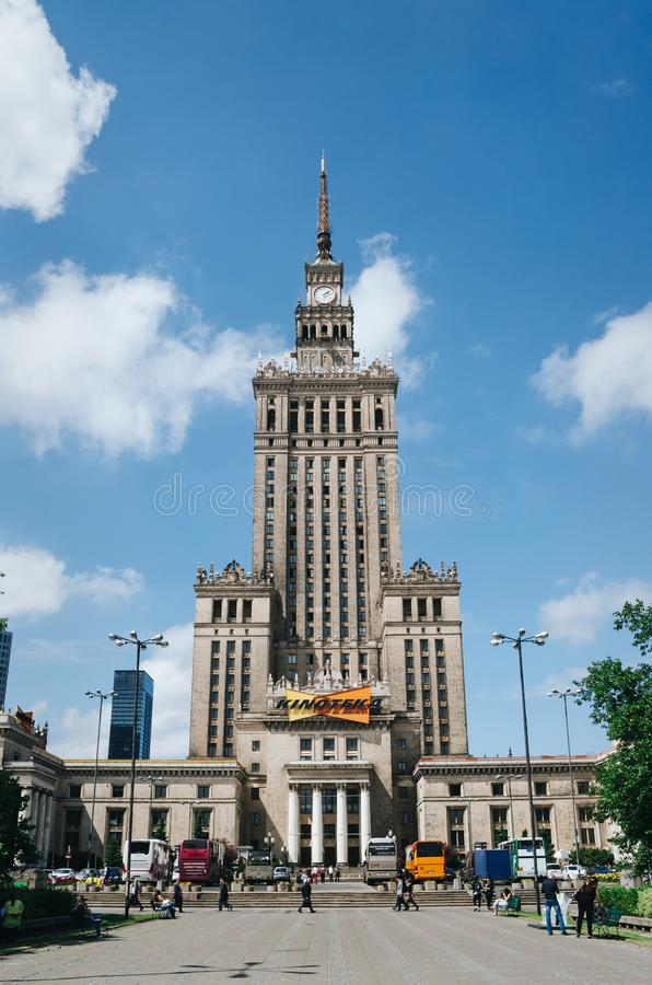 WARSAW, POLAND - JUNE 15, 2016: People walking in front of Palace of Culture and Science, skyscraper, symbol of communism and stock image