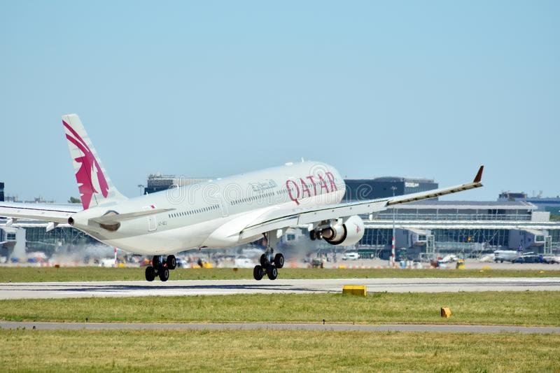 Plane A7-AEJ Qatar Airways Airbus A330-302 just before landing at the Chopin airport. royalty free stock photo