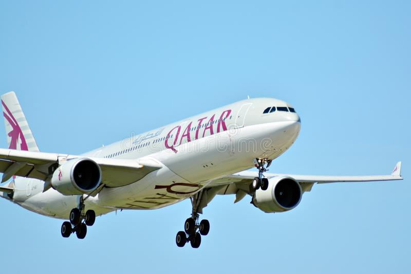 Plane A7-AEJ Qatar Airways Airbus A330-302 just before landing at the Chopin airport. stock photography