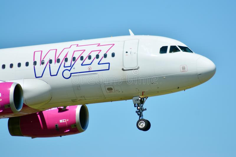 Plane HA-LWH - Airbus A320-232 - Wizz Air just before landing at the Chopin airport. Warsaw, Poland. 8 June 2018. Plane HA-LWH - Airbus A320-232 - Wizz Air just royalty free stock images