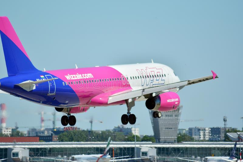 Plane HA-LWH - Airbus A320-232 - Wizz Air just before landing at the Chopin airport. Warsaw, Poland. 8 June 2018. Plane HA-LWH - Airbus A320-232 - Wizz Air just royalty free stock photos