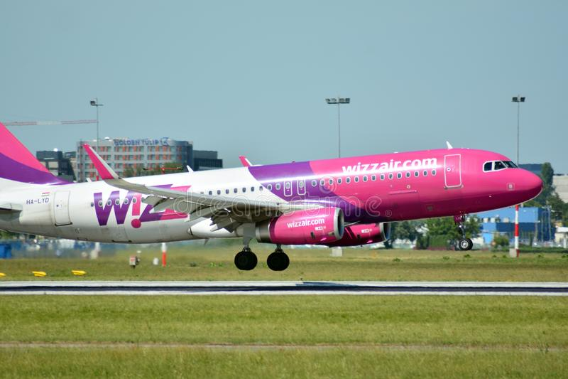 Plane HA-LYD - Airbus A320-232 - Wizz Air just before landing at the Chopin airport. Warsaw, Poland. 8 June 2018. Plane HA-LYD - Airbus A320-232 - Wizz Air just royalty free stock image