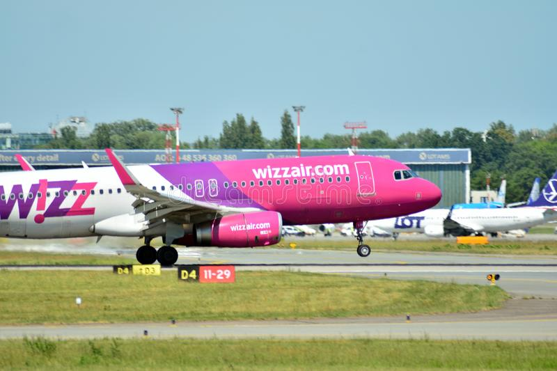 Plane HA-LYD - Airbus A320-232 - Wizz Air just before landing at the Chopin airport. Warsaw, Poland. 8 June 2018. Plane HA-LYD - Airbus A320-232 - Wizz Air just royalty free stock photo