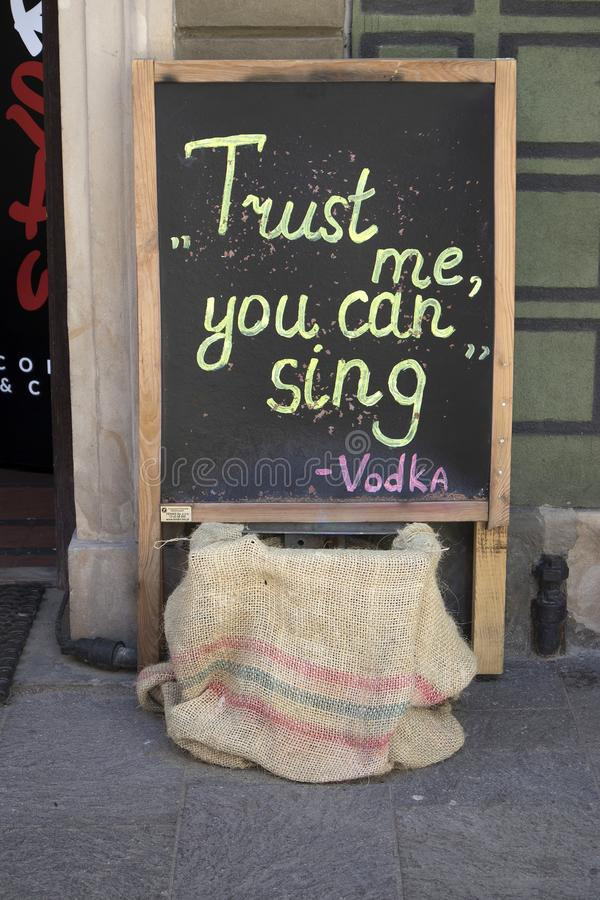 Sign on the chalkboard on the cafe `Thrust me you can sing` royalty free stock images