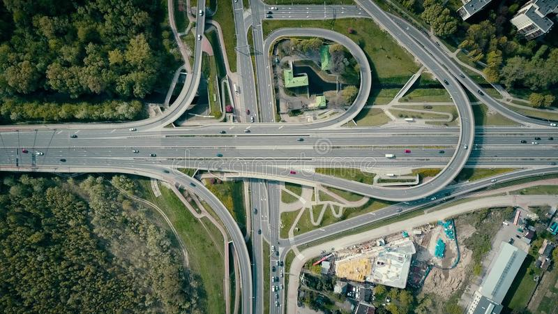 WARSAW, POLAND - MAY, 2, 2017. Aerial shot of road junction on a sunny day, top down view. WARSAW, POLAND - MAY, 2, 2017. Aerial shot of road junction on a sunny stock photos