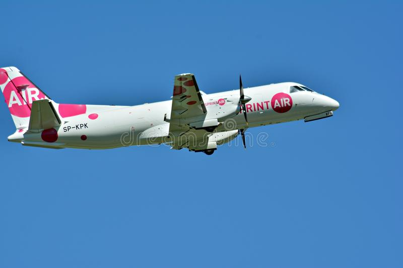 Passenger airplane SP-KPK - Saab 340A - Sprint Air is flying from the runway of Warsaw Chopin Airport. Warsaw, Poland. 28 May 2018. Passenger airplane SP-KPK royalty free stock photography