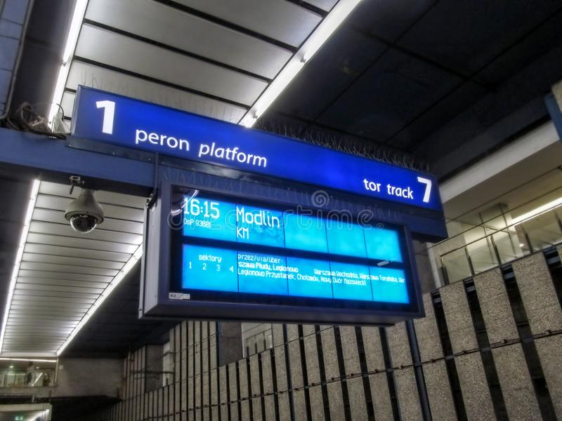 Information display on the platform at the Warszawa Centralna railway station. The scoreboard stock image