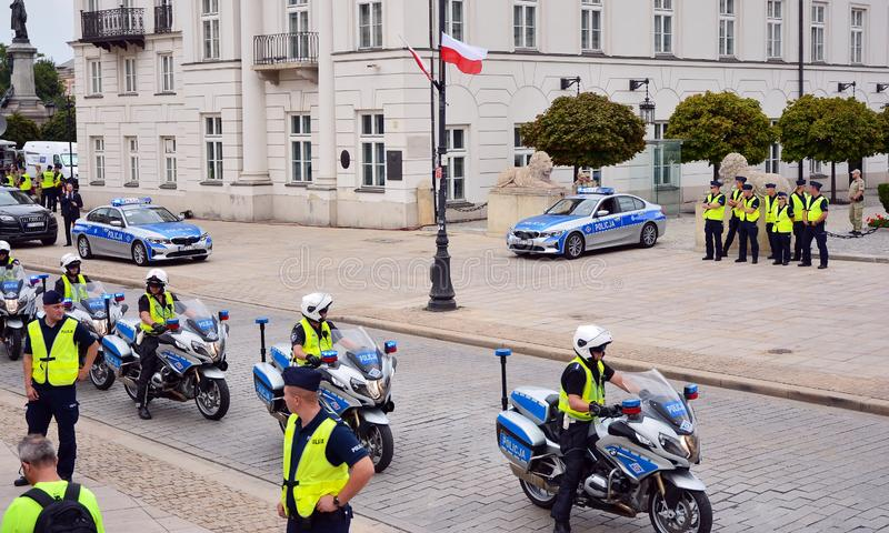 Cortege of a US delegation in Warsaw. The cars of the diplomats surrounded by policemen on police motorcycles. royalty free stock photography