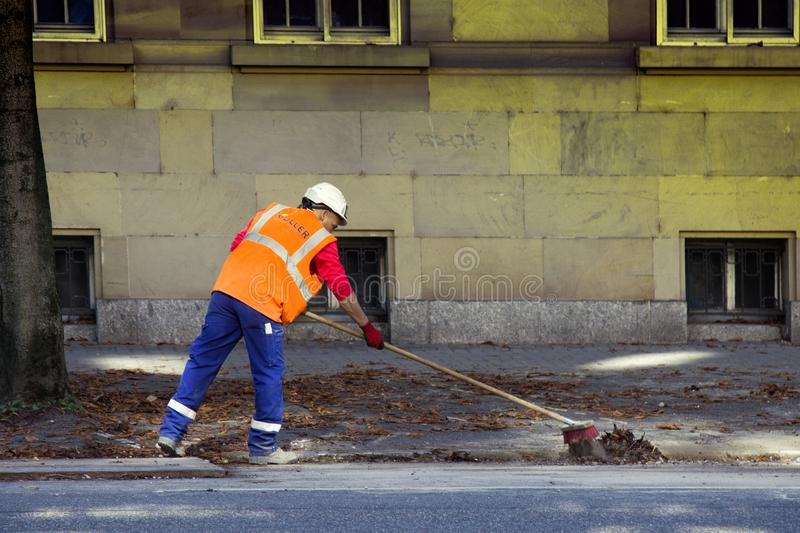 Morning job is janitor, sweep streets stock image