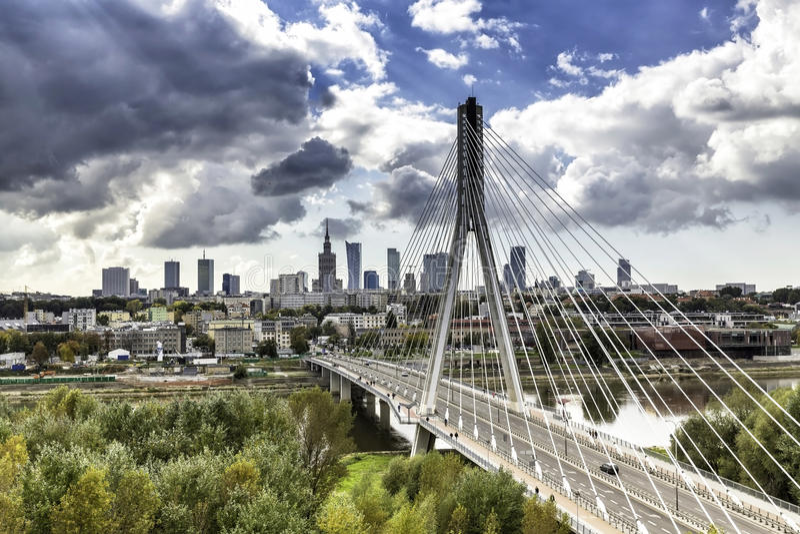 Warsaw skyline behind the bridge royalty free stock image