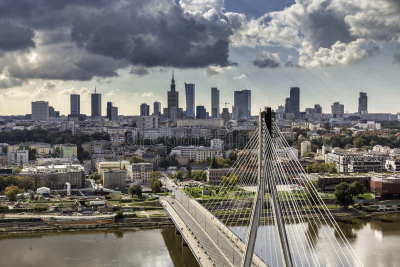 Warsaw skyline behind the bridge stock image