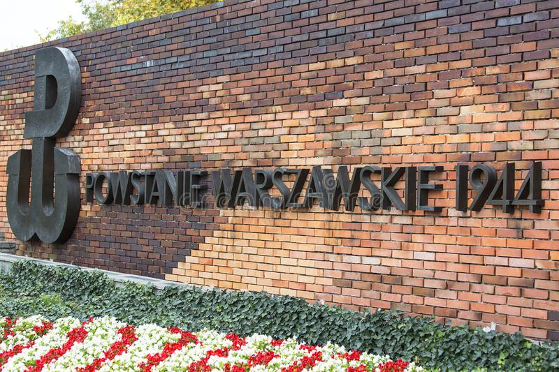 Warsaw Uprising Monument , brick wall with inscription. WARSAW, POLAND -OCTOBER 17, 2019 : Warsaw Uprising Monument in front of Supreme Court of Poland, brick stock photo
