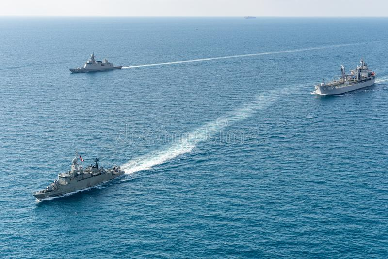 3 warships of Royal Thai Navy and Royal Australian Navy sail in the sea during AusThai 2019 royalty free stock photos