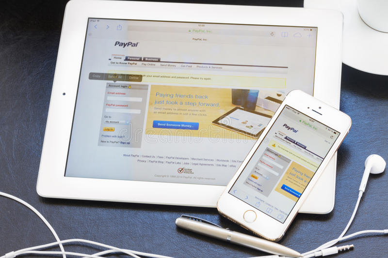 WARSZAWA, POLAND - APRIL 17, 2014. Paypal. On screen of ipad and iphone 5s. PayPal is a popular and international method of money transfer via the Internet stock images