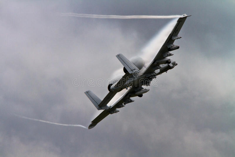 Military A10 Warthog Thunderbolt Jet Aircraft. A-10 Warthog Jet Aircraft displaying a vapour trail stock photo
