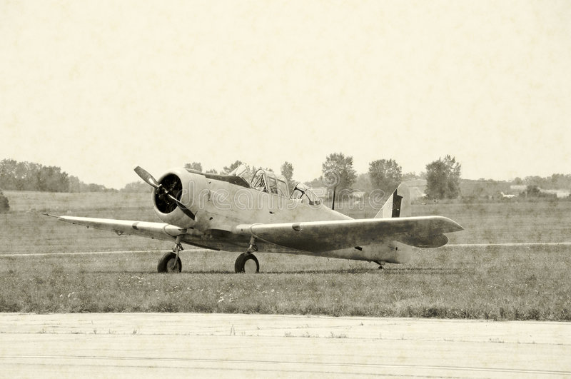 Wartime fighter airplane. Aged photo of classic WWII propeller airplane royalty free stock photos