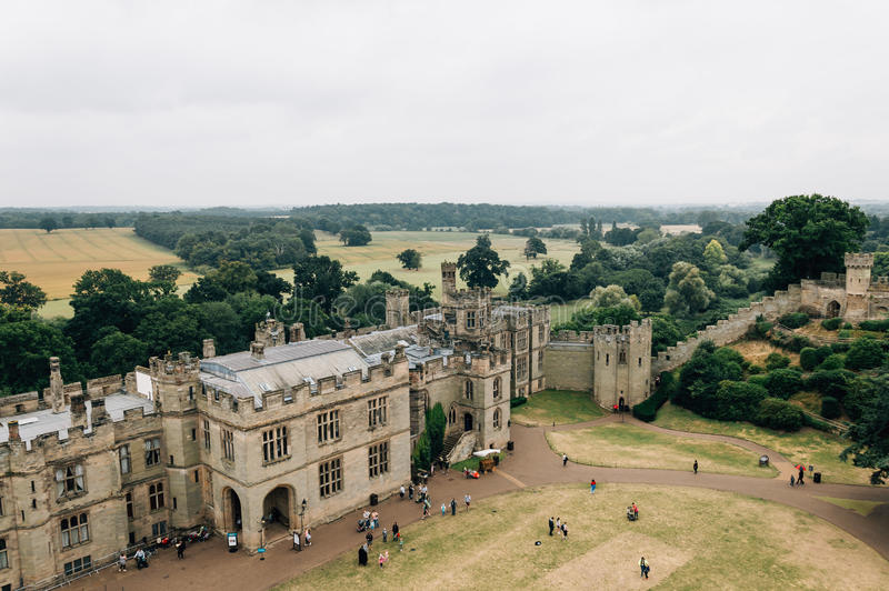 Warwick Castle a cloudy day. High angle view of Warwick Castle. It is a medieval castle built in 11th century by William the Conqueror and a major touristic stock image