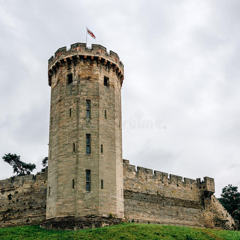 Warwick Castle a cloudy day. Warwick Castle. It is a medieval castle built in 11th century by William the Conqueror and a major touristic attraction in UK royalty free stock photography