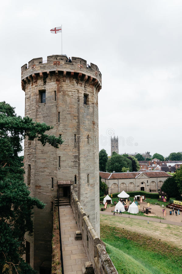 Warwick Castle a cloudy day. Warwick Castle. It is a medieval castle built in 11th century by William the Conqueror and a major touristic attraction in UK royalty free stock photo
