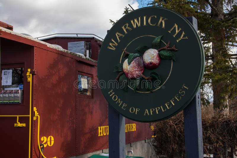 Warwick, NY  United States - 4 January,2019: simbol of city Warwick Home of Applefest. In green disk stock images