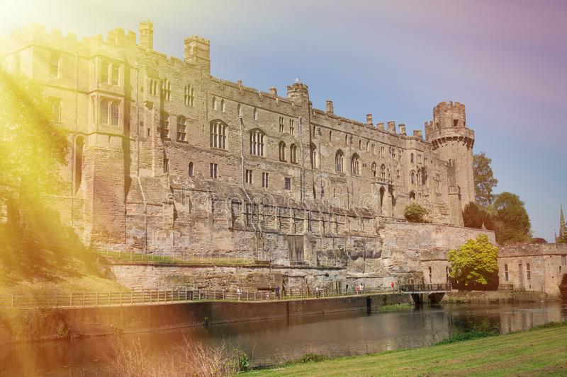 Warwick Castle viewed from the river side. Warwick, Warwick Castle, UK, May5,2018.Warwick Castle viewed from the river side royalty free stock photo