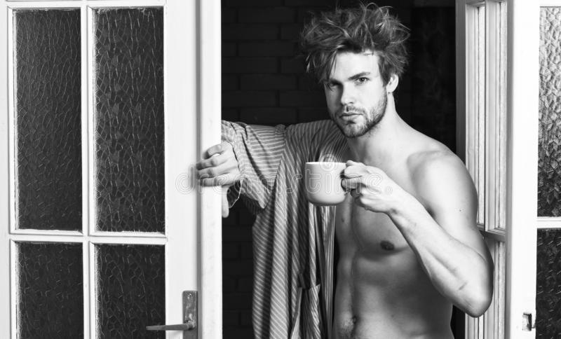 That was great night. Guy attractive lover enjoy morning coffee. Sexy macho tousled hair coming out bedroom door. Seductive lover full of desire. Man lover stock photos