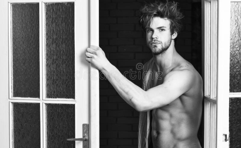 That was great night. Guy attractive lover posing seductive. macho tousled hair coming out bedroom door. Seductive. Lover full of desire. Man lover near door royalty free stock photo
