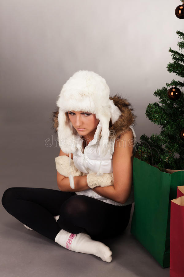 Was I good girl this year?. Young girl thinking if she was good girl this year and Santa presents something good royalty free stock image