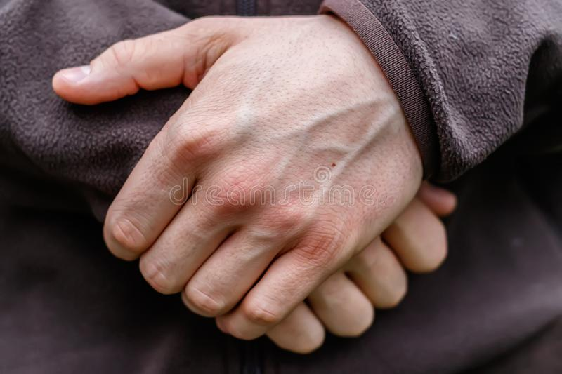 Hands of a young man stock photography