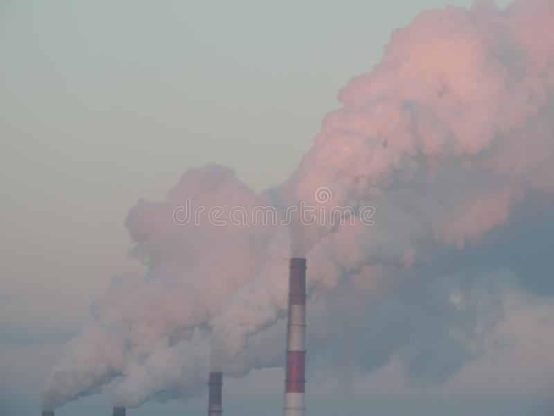 Smoke from pipes of factory. royalty free stock image