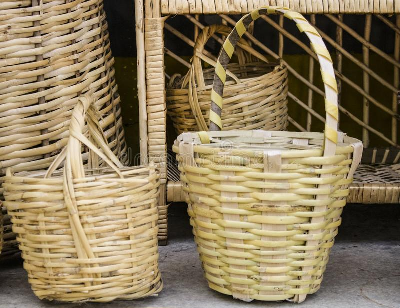 It was taken in front of the store. Knitted baskets. They're yellow. conventional production. Design, handmade, craft, decoration, art, background, market royalty free stock image