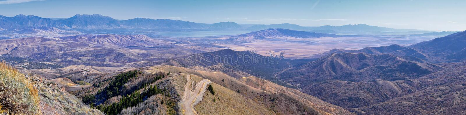 Wasatch Front Rocky Mountain landscapes from Oquirrh range looking at Utah Lake during fall. Panorama views near Provo, Timpanogos. Lone and Twin Peaks. Salt stock photography