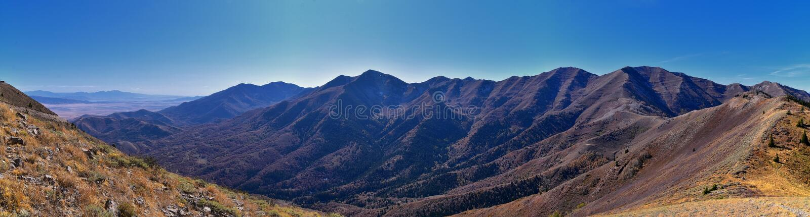 Wasatch Front Rocky Mountain landscapes from Oquirrh range looking at Utah Lake during fall. Panorama views near Provo, Timpanogos. Lone and Twin Peaks. Salt royalty free stock image