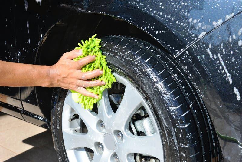 Waschen des Autos stockfotos