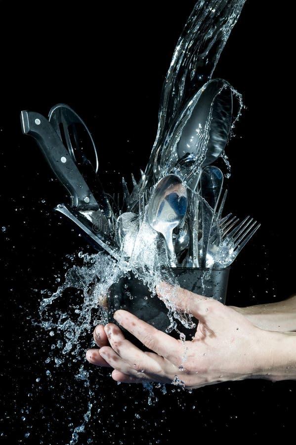 Waschende Küchewaren lizenzfreies stockfoto