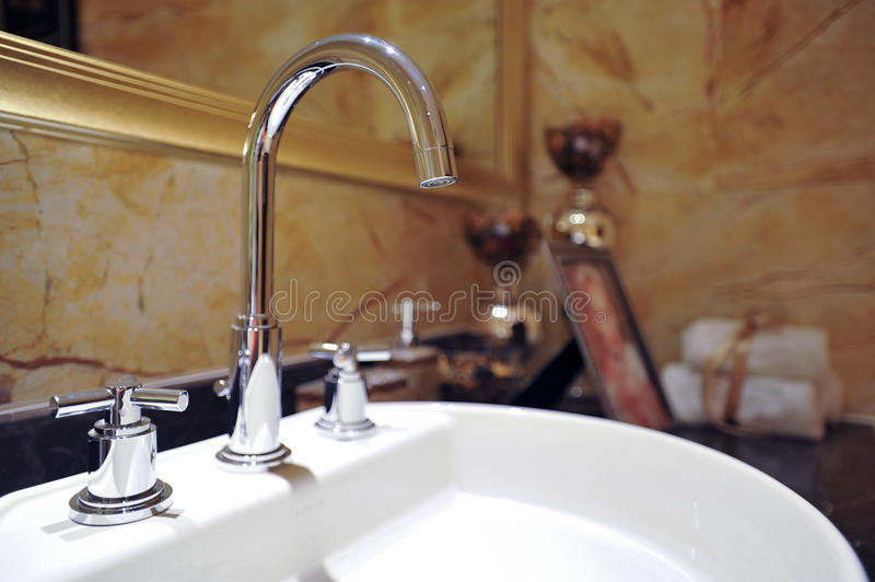 Wash basin. Detail of a modern, contemporary designer bathroom royalty free stock images