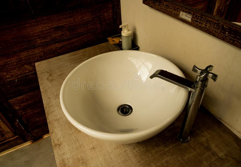 Wash basin and mirrors in the bathroom.  stock image