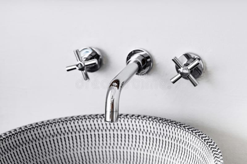 Wash basin modern sink in the bathroom. Chrome-plated water mixer royalty free stock images