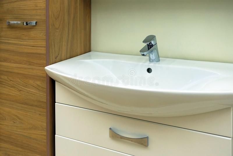 Wash basin modern sink in the bathroom. Chrome-plated water mixer. The mirror above the sink stock photos