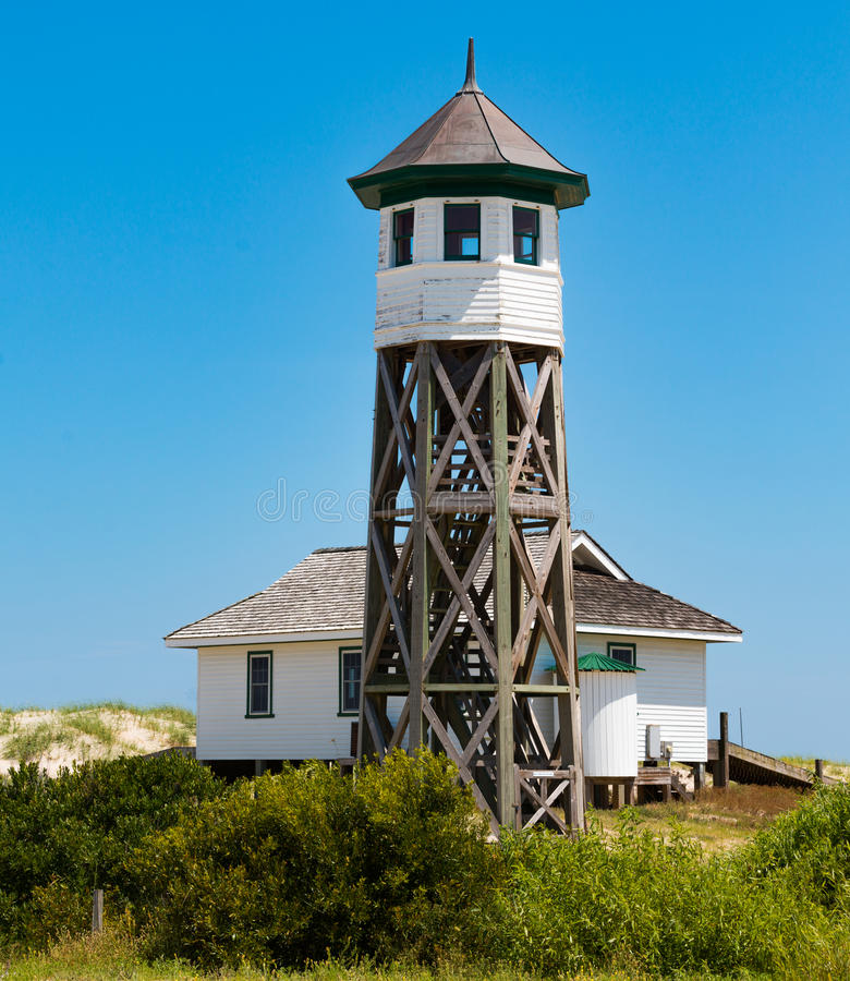Wash Woods Lookout Tower and Boathouse in Corolla, North Carolina. COROLLA, NORTH CAROLINA - JULY 14, 2017: Wash Woods lookout tower and boathouse at the Old royalty free stock photos